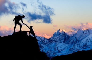 Teamwork Couple Helping Hand, Trust In Mountains. Team Of Climbe